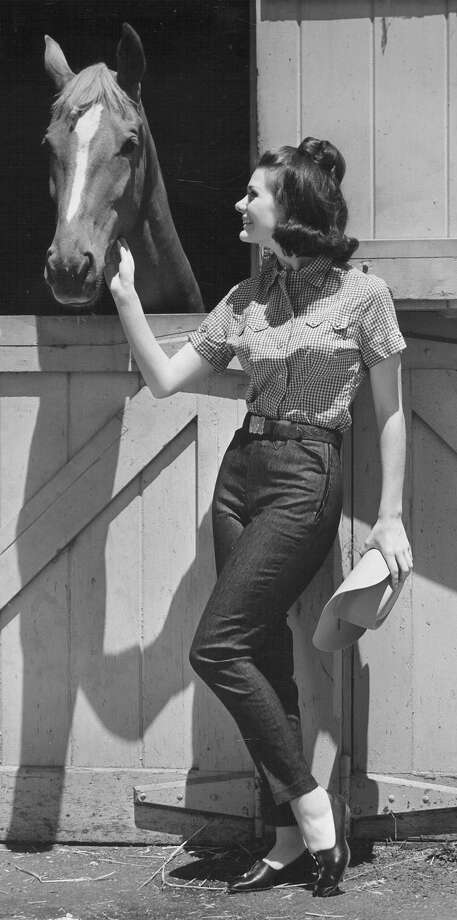 Fashion at the 1967 San Antonio Stock Show & Rodeo includes Lady Levi's stretch denim ranch pants and Levi's checked gingham shirts. Photo: San Antonio Express-News File Photo