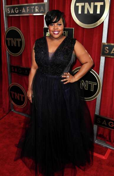 Actress Amber Riley arrives at the 19th Annual Screen Actors Guild Awards at the Shrine Auditorium i