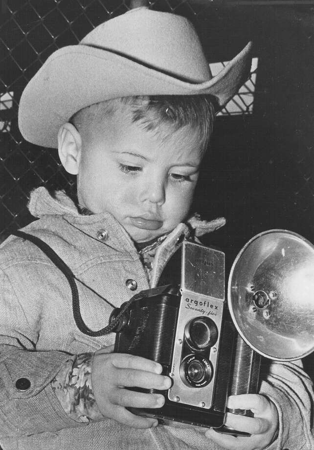 Mark Ploch, 2, tries to take a photo of his brother Gregory and his sheep at the San Antonio Stock Show & Rodeo on Feb. 11, 1967. Photo: San Antonio Express-News File Photo