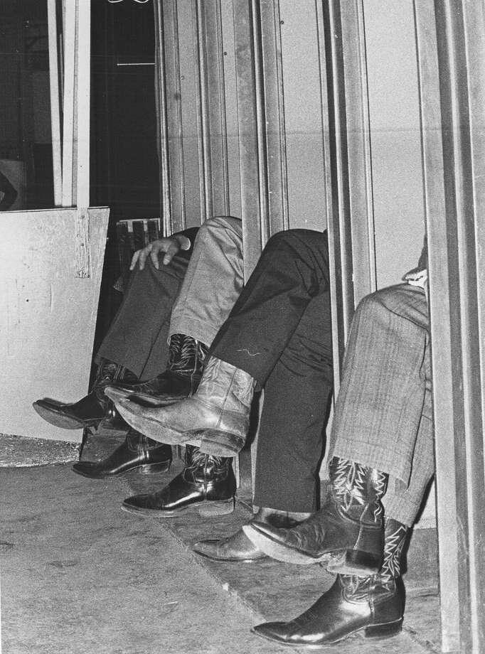 Cowboys take a break at the San Antonio Stock Show & Rodeo on Feb. 15, 1967. Photo: San Antonio Express-News File Photo