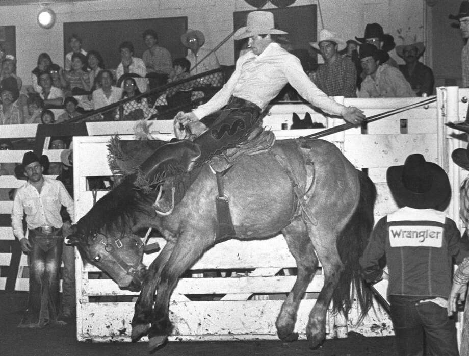 Clay Frazier competes in saddle bronc at the San Antonio Stock Show & Rodeo on Feb. 11, 1984. Photo: San Antonio Express-News File Photo
