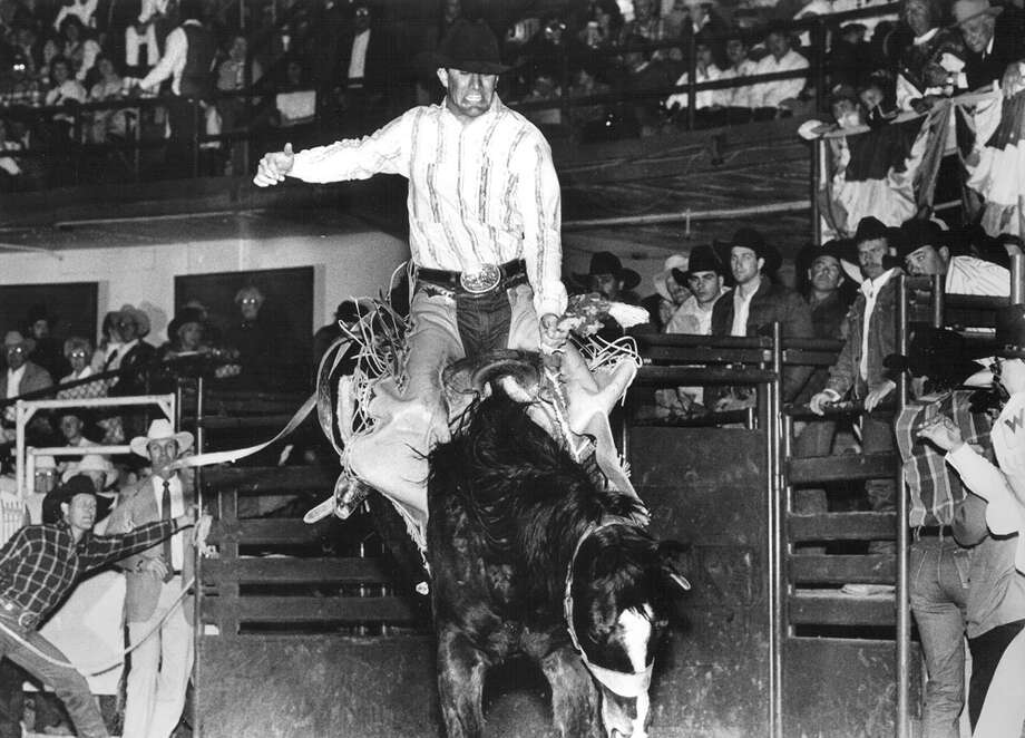 A cowboy competes in bareback riding at the San Antonio Stock Show & Rodeo on Feb. 18, 1990. Photo: San Antonio Express-News File Photo