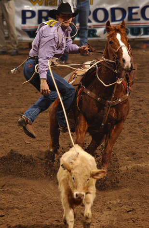 Monty Lewis of Hereford competes in the tie-down roping event during the last performance of the San Antonio Stock Show & Rodeo at the SBC Center on Feb. 22, 2004. Photo: San Antonio Express-News File Photo