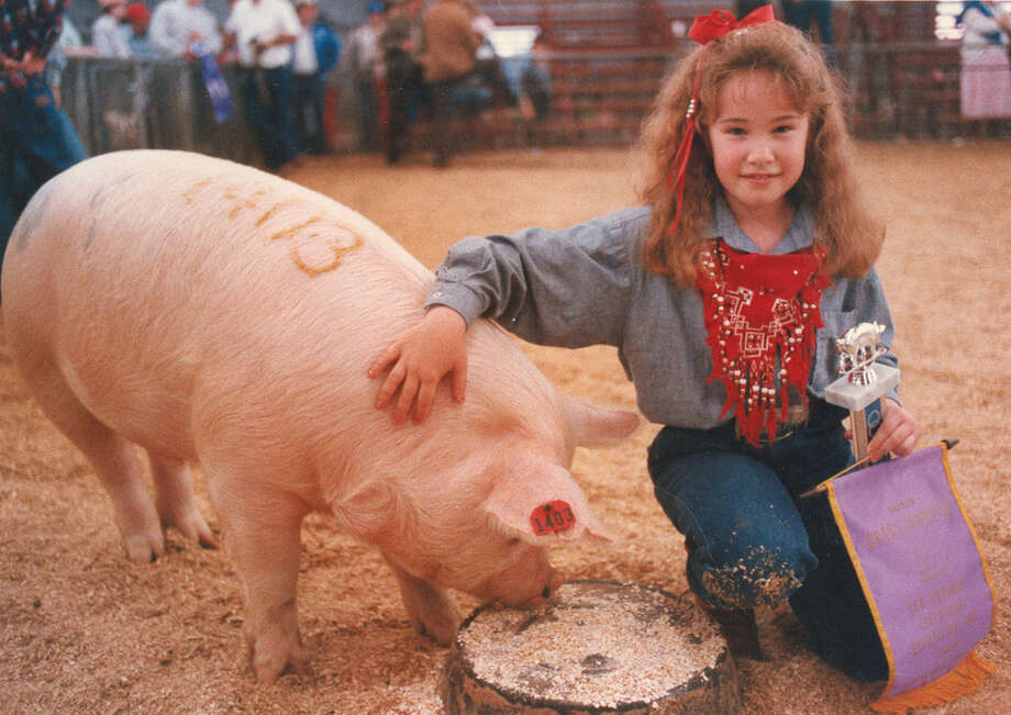 Lubbock County 4H member Shana Schaffner, 9, shows off her Grand Champion Barrow named Bullet at the San Antonio Stock Show & Rodeo on Feb. 17, 1988. Photo: San Antonio Express-News File Photo