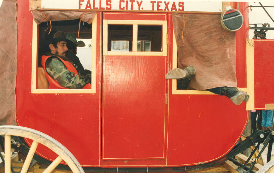 At least one cowboy catches some winks as South Texas trail riders rest in a stagecoach near Karnes City on Feb. 9, 1988. They are on their way to the San Antonio Stock Show & Rodeo. Photo: San Antonio Express-News File Photo