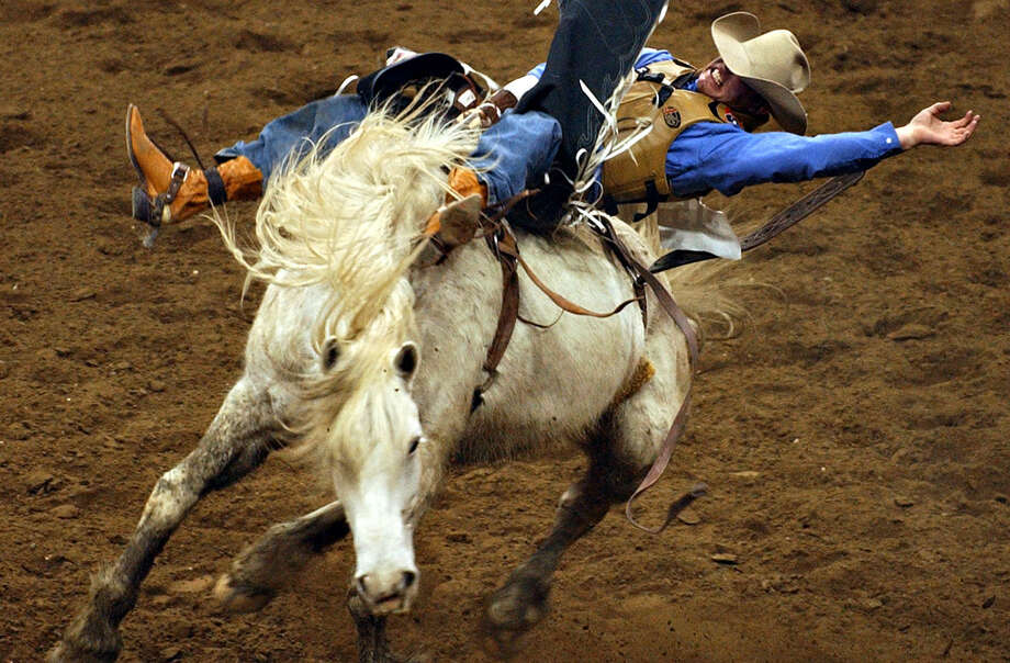 Silas Richards of Denton rides in the bareback competition during the matinee of the San Antonio Stock Show & Rodeo at the SBC Center on Feb. 15, 2004. Photo: San Antonio Express-News File Photo
