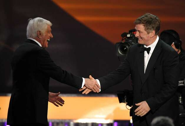 Alec Baldwin, right, presents the presents the Screen Actors Guild Life Achievement Award to Dick Van Dyke at the 19th Annual Screen Actors Guild Awards at the Shrine Auditorium in Los Angeles on Sunday Jan. 27, 2013. (Photo by John Shearer/Invision/AP) Photo: John Shearer, Associated Press