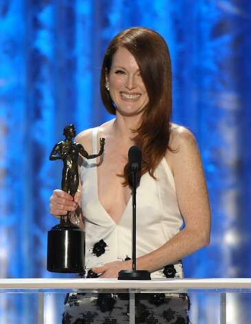 "Julianne Moore accepts the award for outstanding female actor in a TV movie or miniseries for ""Game Change"" at the 19th Annual Screen Actors Guild Awards at the Shrine Auditorium in Los Angeles on Sunday, Jan. 27, 2013. (Photo by John Shearer/Invision/AP) Photo: John Shearer, Associated Press"