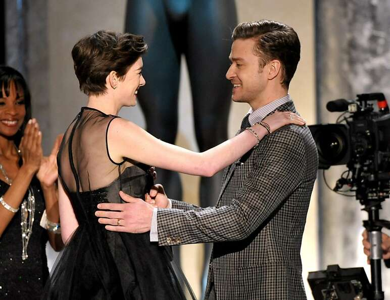 Justin Timberlake, right, congratulates Anne Hathaway on winning the award for outstanding female ac