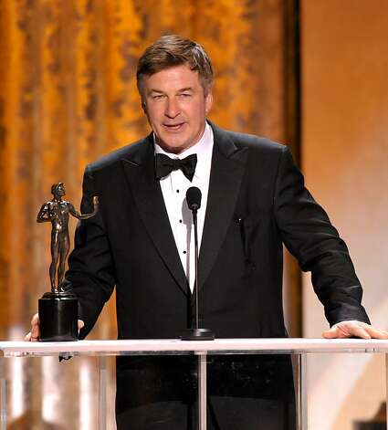"Alec Baldwin accepts the award for outstanding male actor in a comedy series for ""30 Rock"" at the 19th Annual Screen Actors Guild Awards at the Shrine Auditorium in Los Angeles on Sunday Jan. 27, 2013. (Photo by John Shearer/Invision/AP) Photo: John Shearer, Associated Press"