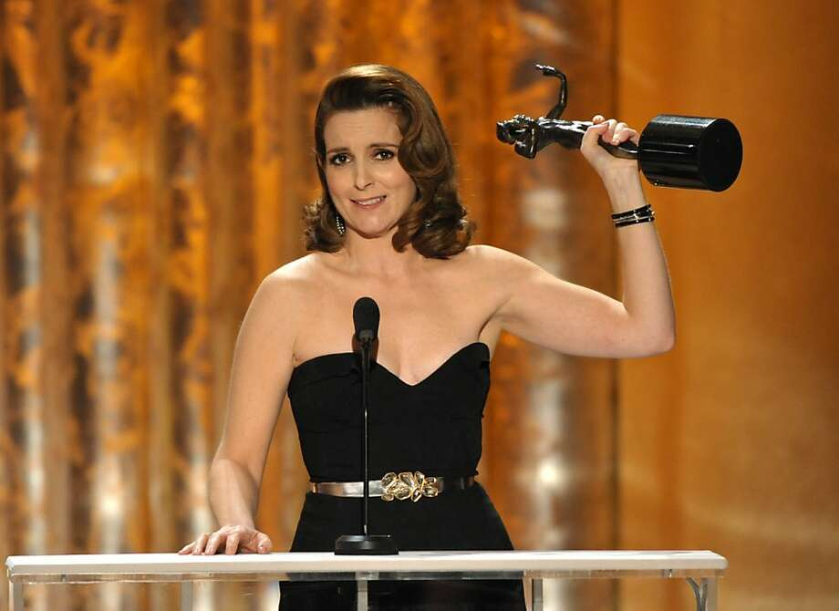 "Tina Fey accepts the award for outstanding female actor in a comedy series for ""30 Rock"" at the 19th Annual Screen Actors Guild Awards at the Shrine Auditorium in Los Angeles on Sunday Jan. 27, 2013. (Photo by John Shearer/Invision/AP) Photo: John Shearer, Associated Press"