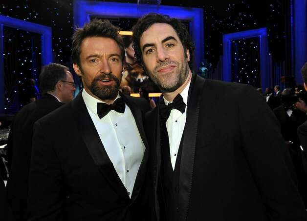 Sacha Baron Cohen, right, and Hugh Jackman pose for a photo in the audience at the 19th Annual Screen Actors Guild Awards at the Shrine Auditorium in Los Angeles on Sunday Jan. 27, 2013. (Photo by John Shearer/Invision/AP) Photo: John Shearer, Associated Press