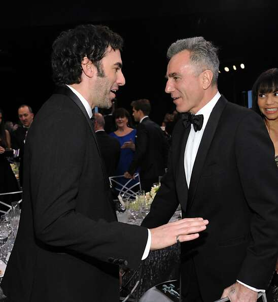 Sacha Baron Cohen, left, and Daniel Day Lewis appear in the audience at the 19th Annual Screen Actor