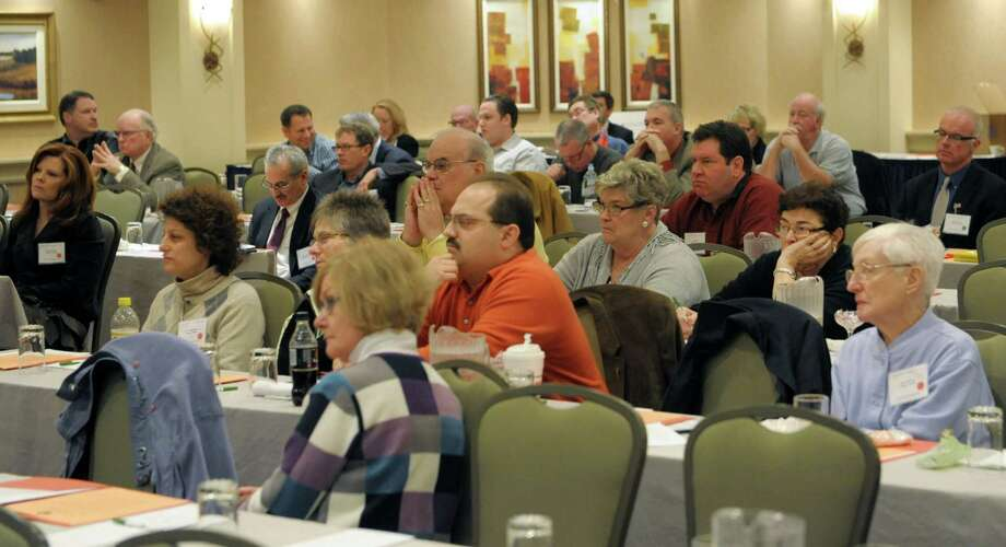Attendees at The Conservative Party Political Annual Conference (CPPAC) listen as Grover Norquist of Americans for Tax Reform addresses them during at the Holiday Inn on Sunday, Jan. 27, 2013 in Albany, NY.  (Paul Buckowski / Times Union) Photo: Paul Buckowski  / 00020907A
