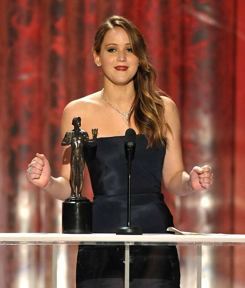 "Jennifer Lawrence accepts the award for outstanding female actor in a leading role for ""Silver Linings Playbook"" at the 19th Annual Screen Actors Guild Awards at the Shrine Auditorium in Los Angeles on Sunday Jan. 27, 2013. (Photo by John Shearer/Invision/AP) Photo: John Shearer, Associated Press"
