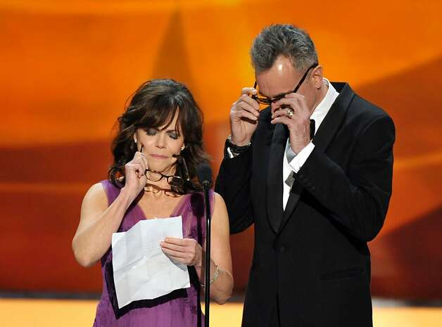 Sally Field, left, and Daniel Day-Lewis put on their glasses onstage at the 19th Annual Screen Actors Guild Awards at the Shrine Auditorium in Los Angeles on Sunday Jan. 27, 2013. (Photo by John Shearer/Invision/AP) Photo: John Shearer, Associated Press