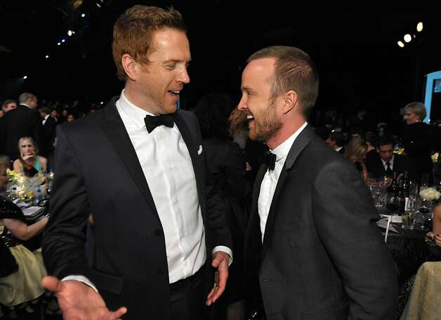 Damian Lewis, left, and Aaron Paul talk together in the audience at the 19th Annual Screen Actors Guild Awards at the Shrine Auditorium in Los Angeles on Sunday Jan. 27, 2013. (Photo by John Shearer/Invision/AP) Photo: John Shearer, Associated Press