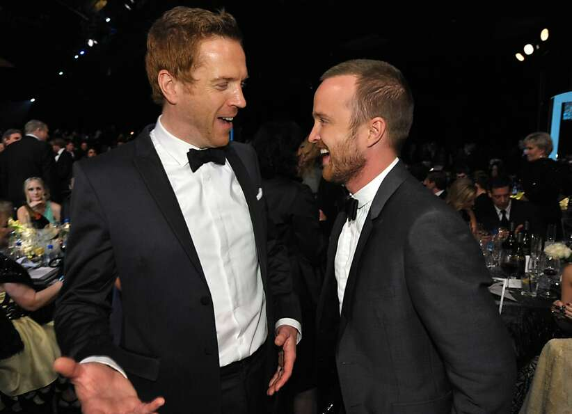 Damian Lewis, left, and Aaron Paul talk together in the audience at the 19th Annual Screen Actors Gu