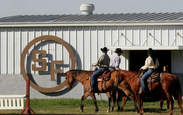 "In this photo made Tuesday, Nov. 13, 2012, stunt riders prepare to shoot a scene for the TV show Dallas at Southfork Ranch in Parker, Texas. Tourists have been flocking to Southfork Ranch since the early years of the classic series, which ran from 1978 to 1991. And a new ""Dallas"" starting its second season on TNT on Monday and the recent death of the show's star, Larry Hagman, who legendarily played conniving Texas oilman J.R. Ewing, have also spurred fans to visit. (AP Photo/LM Otero) Photo: LM Otero, Associated Press / AP"
