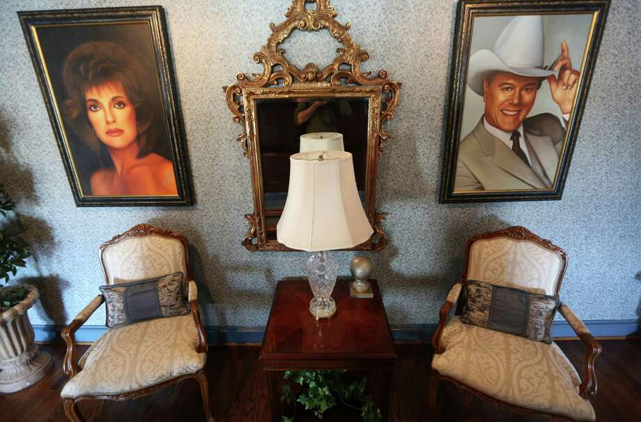 "This photo made Tuesday, Nov. 13, 2012, shows paintings of actors in the Dallas TV show that are displayed in the mansion open to visitors at Southfork Ranch in Parker, Texas. Tourists have been flocking to Southfork Ranch since the early years of the classic series, which ran from 1978 to 1991. And a new ""Dallas"" starting its second season on TNT on Monday and the recent death of the show's star, Larry Hagman, who legendarily played conniving Texas oilman J.R. Ewing, have also spurred fans to visit. (AP Photo/LM Otero) Photo: LM Otero, Associated Press / AP"