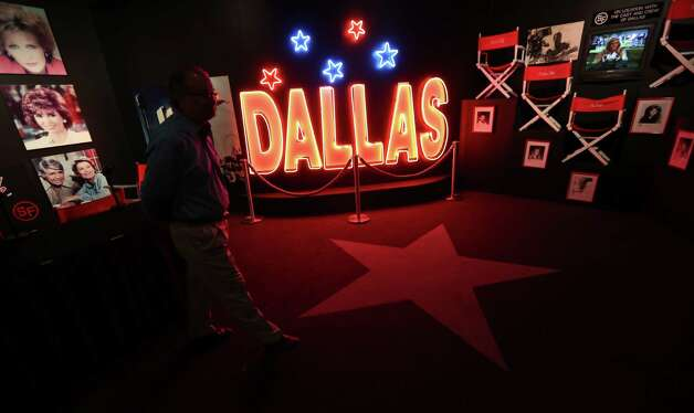 "In this photo made Tuesday, Nov. 13, 2012, a tourist looks at the Dallas TV show museum at Southfork Ranch in Parker, Texas. Tourists have been flocking to Southfork Ranch since the early years of the classic series, which ran from 1978 to 1991. And a new ""Dallas"" starting its second season on TNT on Monday and the recent death of the show's star, Larry Hagman, who legendarily played conniving Texas oilman J.R. Ewing, have also spurred fans to visit. (AP Photo/LM Otero) Photo: LM Otero, Associated Press / AP"