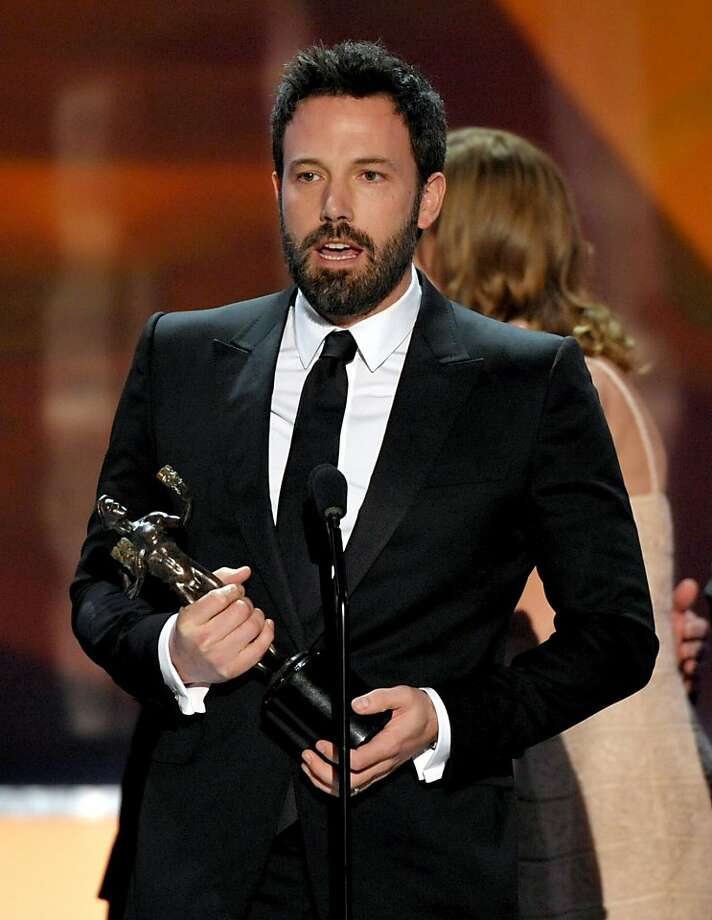 "Ben Affleck accepts the award for outstanding cast in a motion picture for ""Argo"" at the 19th Annual Screen Actors Guild Awards at the Shrine Auditorium in Los Angeles on Sunday Jan. 27, 2013. (Photo by John Shearer/Invision/AP) Photo: John Shearer, Associated Press"