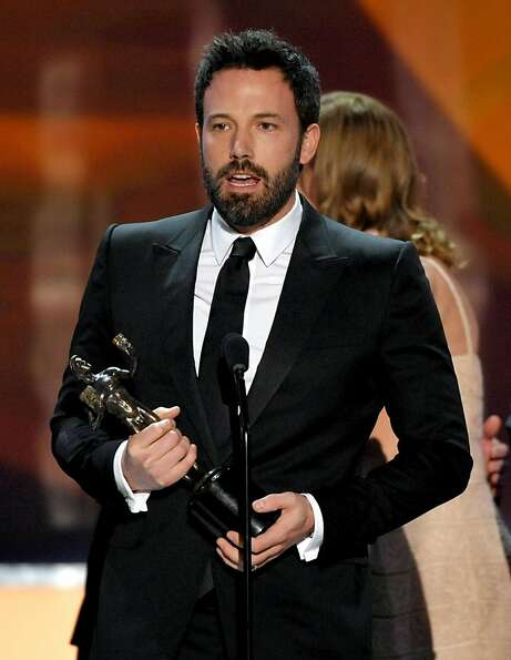 "Ben Affleck accepts the award for outstanding cast in a motion picture for ""Argo"" at the 19th An"