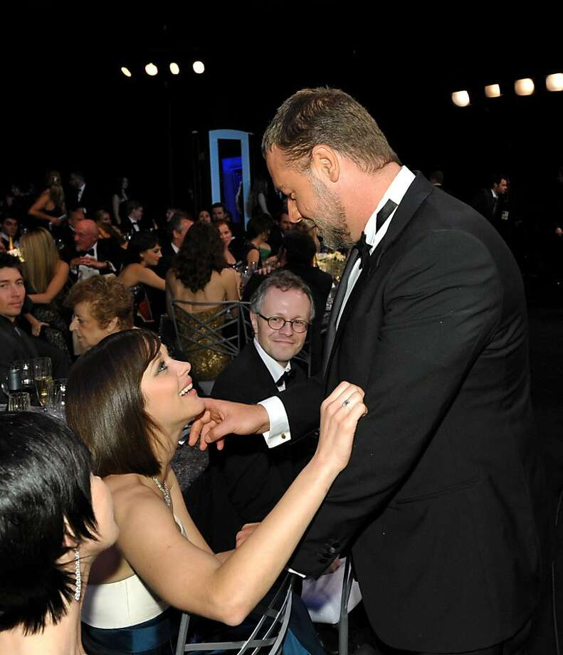 Actress Marion Cotillard, left, and Russell Crowe speak in the audience at the 19th Annual Screen Actors Guild Awards at the Shrine Auditorium in Los Angeles on Sunday Jan. 27, 2013. (Photo by John Shearer/Invision/AP) Photo: John Shearer, Associated Press