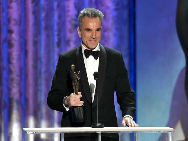 "Daniel Day-Lewis accepts the awards for outstanding male actor in a leading role for ""Lincoln"" at the 19th Annual Screen Actors Guild Awards at the Shrine Auditorium in Los Angeles on Sunday Jan. 27, 2013. (Photo by John Shearer/Invision/AP) Photo: John Shearer, Associated Press"