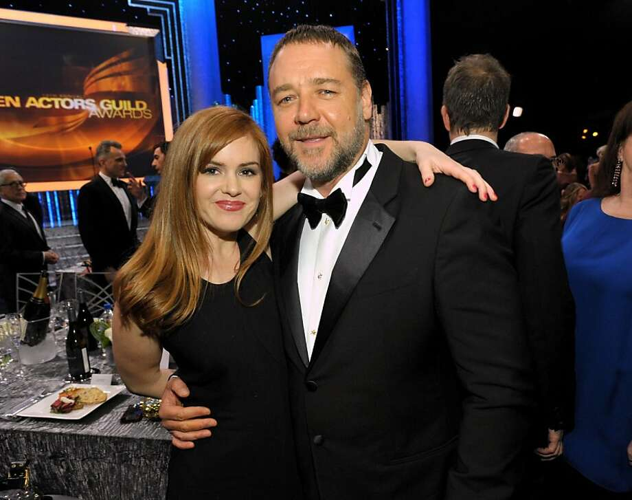 Isla Fisher, left, and Russell Crowe pose in the audience at the 19th Annual Screen Actors Guild Awards at the Shrine Auditorium in Los Angeles on Sunday Jan. 27, 2013. (Photo by John Shearer/Invision/AP) Photo: John Shearer, Associated Press