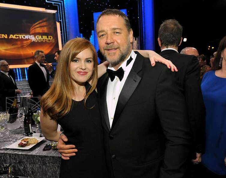 Isla Fisher, left, and Russell Crowe pose in the audience at the 19th Annual Screen Actors Guild Awa