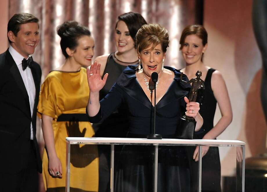 "Phyllis Logan accepts the award for outstanding ensemble in a drama series for ""Downton Abbey""at the 19th Annual Screen Actors Guild Awards at the Shrine Auditorium in Los Angeles on Sunday Jan. 27, 2013. (Photo by John Shearer/Invision/AP) Photo: John Shearer, Associated Press"