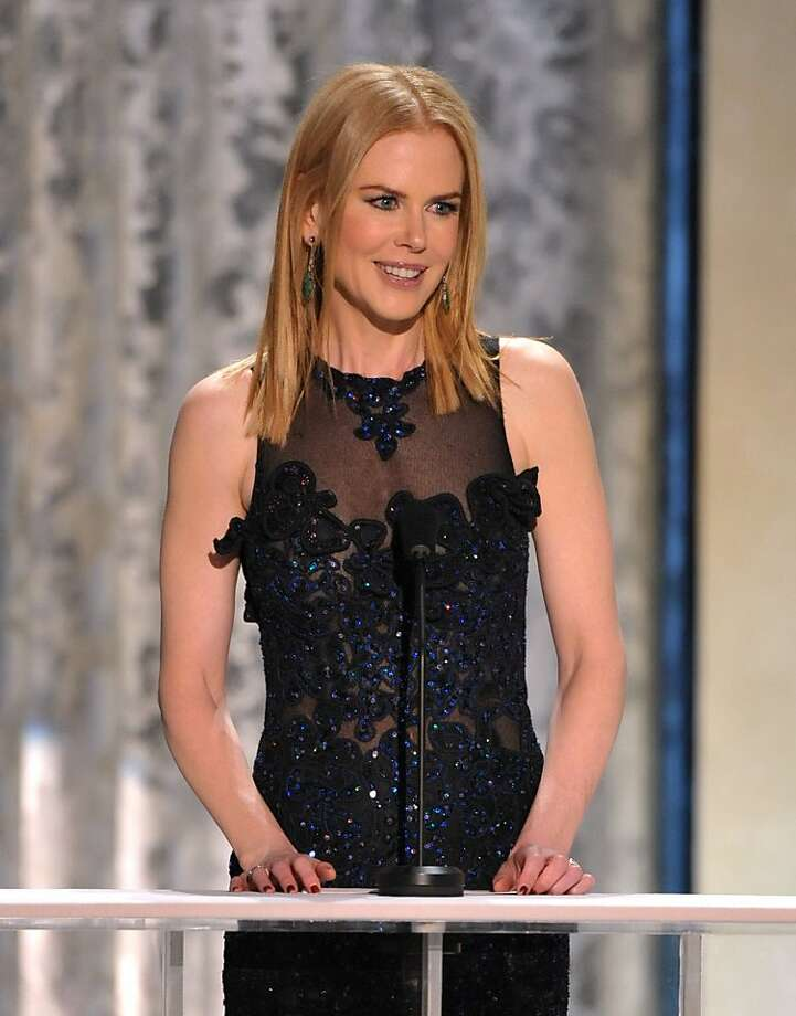 "Nicole Kidman presents the award for outstanding male actor in a supporting role to Tommy Lee Jones for his role in ""Lincoln,"" at the 19th Annual Screen Actors Guild Awards at the Shrine Auditorium in Los Angeles on Sunday Jan. 27, 2013. (Photo by John Shearer/Invision/AP) Photo: John Shearer, Associated Press"