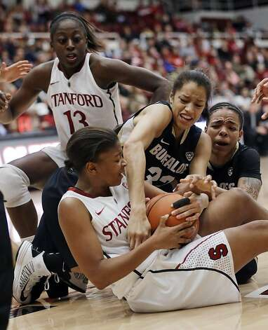 Stanford's Amber Orrange, bottom, scrambles for a loose ball with Colorado's Arielle Roberson (32) and Chucky Jeffery, right, as Stanford's Chiney Ogwumike (13) watches during the second half of an NCAA college basketball game in Stanford, Calif., Sunday, Jan. 27, 2013. Stanford won 69-56. (AP Photo/Marcio Jose Sanchez) Photo: Marcio Jose Sanchez, Associated Press