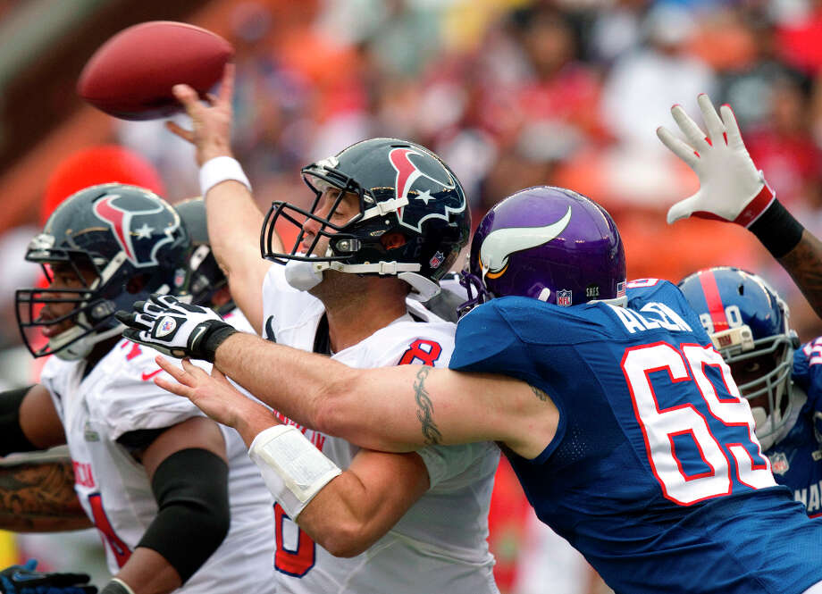 Texans quarterback Matt Schaub (8) manages to throw a pass just as Vikings defensive end Jared Allen (69) grabs him. Photo: Eugene Tanner, Associated Press / FR168001 AP