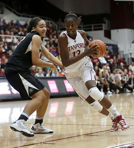 Stanford's Chiney Ogwumike (13) dribbles past Colorado's Jamee Swan during the second half of an NCAA college basketball game in Stanford, Calif., Sunday, Jan. 27, 2013. Stanford won 69-56. (AP Photo/Marcio Jose Sanchez) Photo: Marcio Jose Sanchez, Associated Press