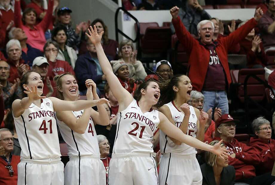 Stanford's Bonnie Samuelson (41), Taylor Greenfield (4), Sara James (21) and Erica Payne (25) celebrate in the closing seconds of a 69-56 win over Colorado in an NCAA college basketball game in Stanford, Calif., Sunday, Jan. 27, 2013. (AP Photo/Marcio Jose Sanchez) Photo: Marcio Jose Sanchez, Associated Press