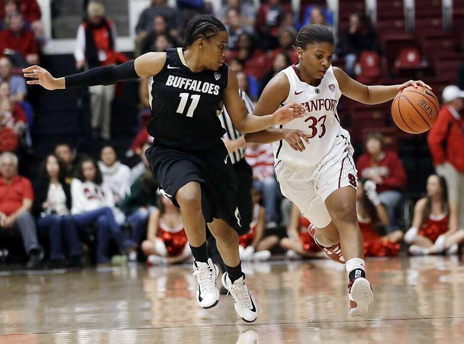 Stanford's Amber Orrange (33) brings the ball up as Colorado's Brittany Wilson (11) defends during the second half of an NCAA college basketball game in Stanford, Calif., Sunday, Jan. 27, 2013. Stanford won 69-56. (AP Photo/Marcio Jose Sanchez) Photo: Marcio Jose Sanchez, Associated Press