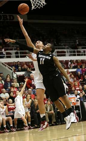 Stanford 's Joslyn Tinkle, left, scores past Colorado 's Brittany Wilson (11) during the second half of an NCAA college basketball game in Stanford, Calif., Sunday, Jan. 27, 2013. Stanford won 69-56. (AP Photo/Marcio Jose Sanchez) Photo: Marcio Jose Sanchez, Associated Press