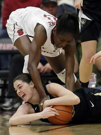 Colorado 's Meagan Malcolm-Peck (14), bottom, battles for a loose ball against Stanford's Chiney Ogwumike (13) during the first half of an NCAA college basketball game in Stanford, Calif., Sunday, Jan. 27, 2013. (AP Photo/Marcio Jose Sanchez) Photo: Marcio Jose Sanchez, Associated Press