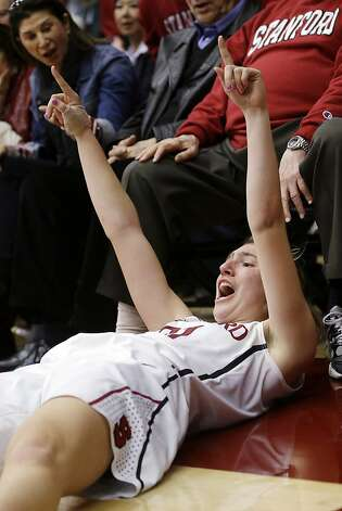 Stanford 's Toni Kokenis gestures after sinking a 3-point basket and being fouled by a Colorado player during the second half of an NCAA college basketball game in Stanford, Calif., Sunday, Jan. 27, 2013. Stanford won 69-56. (AP Photo/Marcio Jose Sanchez) Photo: Marcio Jose Sanchez, Associated Press