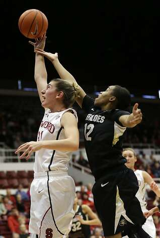 Stanford 's Toni Kokenis (31) jumps for a rebound next to Colorado 's Ashley Wilson (12) during the first half of an NCAA college basketball game in Stanford, Calif., Sunday, Jan. 27, 2013. (AP Photo/Marcio Jose Sanchez) Photo: Marcio Jose Sanchez, Associated Press