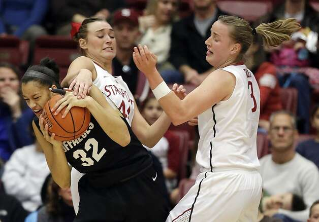 Colorado 's Arielle Roberson (32), left, grabs a rebound next to Stanford 's Joslyn Tinkle (44) and Mikaela Ruef (3) during the first half of an NCAA college basketball game in Stanford, Calif., Sunday, Jan. 27, 2013. (AP Photo/Marcio Jose Sanchez) Photo: Marcio Jose Sanchez, Associated Press