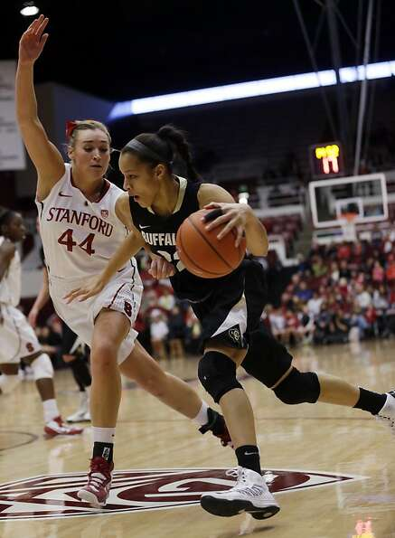 Colorado 's Arielle Roberson (32) dribbles past Stanford 's Joslyn Tinkle (44) during the first half