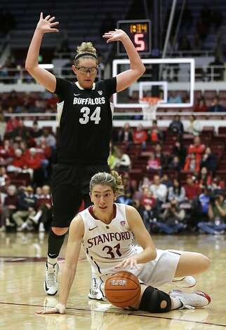 Stanford 's Toni Kokenis (31) controls the ball as she falls down next to Colorado 's Jen Reese (34) during the second half of an NCAA college basketball game in Stanford, Calif., Sunday, Jan. 27, 2013. Stanford won 69-56. (AP Photo/Marcio Jose Sanchez) Photo: Marcio Jose Sanchez, Associated Press