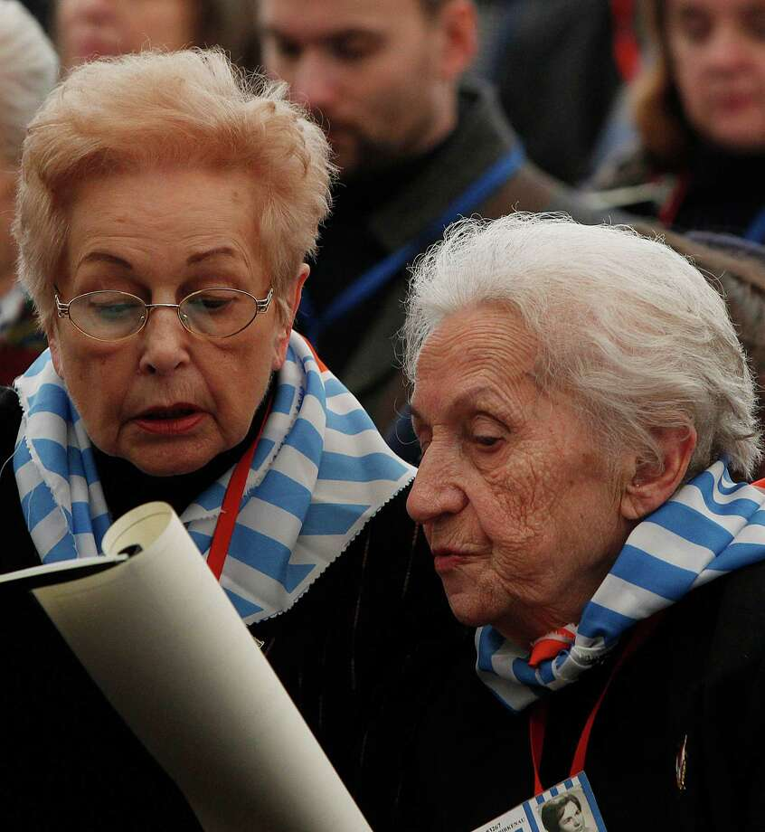 Former prisoners  of the Auschwitz concentration camp attend  a ceremony  in Oswiecim, Poland, Sunday, Jan. 27, 2013, marking the 68th anniversary of the liberation of Auschwitz by Soviet troops and  remembering the victims of the Holocaust, in Auschwitz-Birkenau.  (AP Photo/Czarek Sokolowski) Photo: Czarek Sokolowski