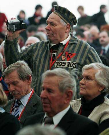 A former prisoner of the Auschwitz concentration camp  films the celebrations  in Oswiecim, Poland, Sunday, Jan. 27, 2013,  marking the 68th anniversary of the liberation of Auschwitz by Soviet troops and  remembering  the victims of the Holocaust, in Auschwitz-Birkenau.  (AP Photo/Czarek Sokolowski) Photo: Czarek Sokolowski