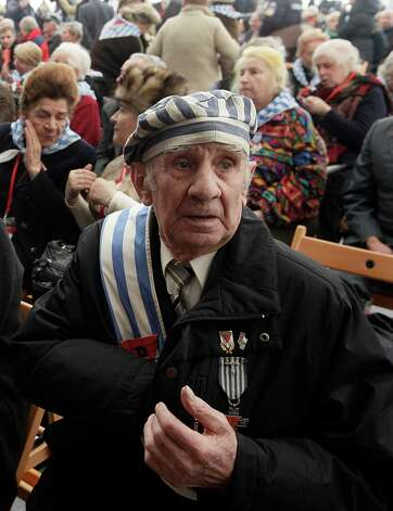 Former prisoner Miroslaw Celka, 89, attends a ceremony at  the Auschwitz concentration camp  in Oswiecim, Poland, Sunday, Jan. 27, 2013,  marking the 68th anniversary of the liberation of Auschwitz by Soviet troops and  remembering  the victims of the Holocaust, in Auschwitz-Birkenau.  (AP Photo/Czarek Sokolowski) Photo: Czarek Sokolowski