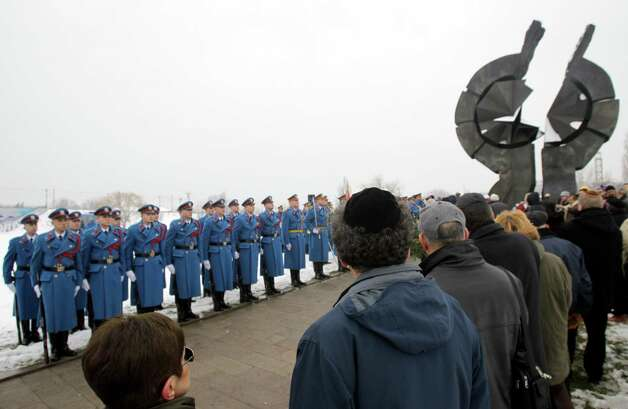 Serbian military honor guards stand to attention as people attend commemorations for victims of the Holocaust at a monument erected in the former World War II Nazi concentration camp of Sajmiste in Belgrade, Serbia, Sunday, Jan. 27, 2013. The ceremony coincided with International Holocaust Remembrance Day, which marks the liberation of the Auschwitz Nazi concentration camp on Jan. 27, 1945. (AP Photo/Darko Vojinovic) Photo: Darko Vojinovic