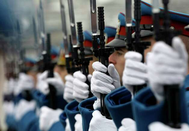 Serbian military honor guards participate in commemorations for victims of the Holocaust at the former World War II Nazi concentration camp of Sajmiste in Belgrade, Serbia, Sunday, Jan. 27, 2013. The ceremony coincided with International Holocaust Remembrance Day, which marks the liberation of the Auschwitz Nazi concentration camp on Jan. 27, 1945. (AP Photo/Darko Vojinovic) Photo: Darko Vojinovic